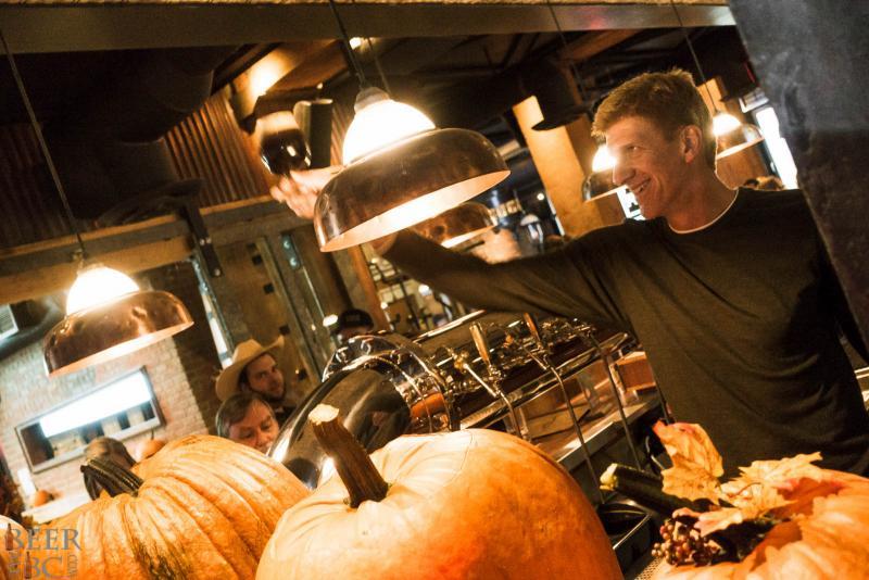 Gary Lohin Cheersing a Pumpkin Beer