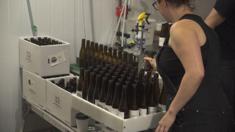 Flights Series Two 33 Acres Staff Bottling Beer